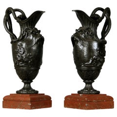 A Pair of Late 19th Century Bronze and Griotte Uni Marble Ewers After Clodion