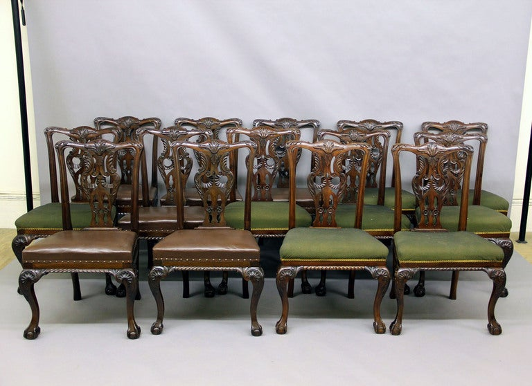 A large and fantastic matched set of 18 late 19th century English Chippendale style dining room chairs. Consisting of 12 side chairs and four armchairs. Each with a hand-carved cabriole leg running down to the typical ball and claw