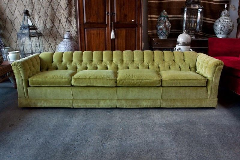 Luxurious 9 feet long sofa in olive green mohair.<br /> Elegant American Mid-Century modern button tufted in the manner of Milo Baughman.<br /> An incredibly comfortable deep custom sofa with original olive green mohair.<br /> Plush and perfectly