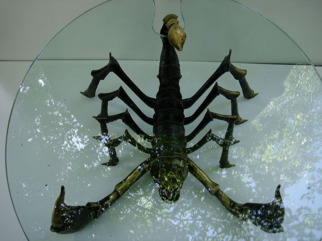 Scorpion bronze table with a lamp in the tail which curves above the table itself. Table attributed to Jacques Duval Brasseur.   Exceptional piece and it is a one-off and by the quality as well as the techniques used.