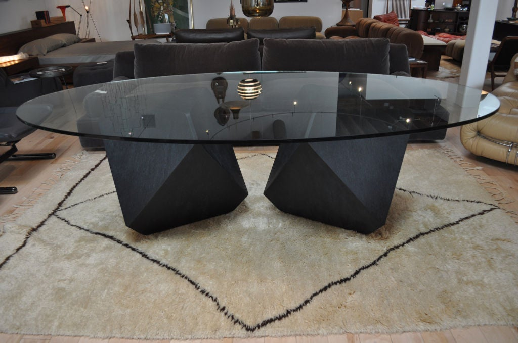 Glass top dining room table handcrafted by American designer William Earle. Finished as shown in black maple bird's-eye. Different wood options and glass top options available (round, oval, square, rectangular) Different base configurations