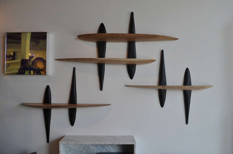 The Tulsi shelves are hand sculpted bleached and ebonized walnut eloquently created and shaped to mount on the wall.  Sold individually.   Custom options available.  Made to order. Contact Siglo Moderno for information.