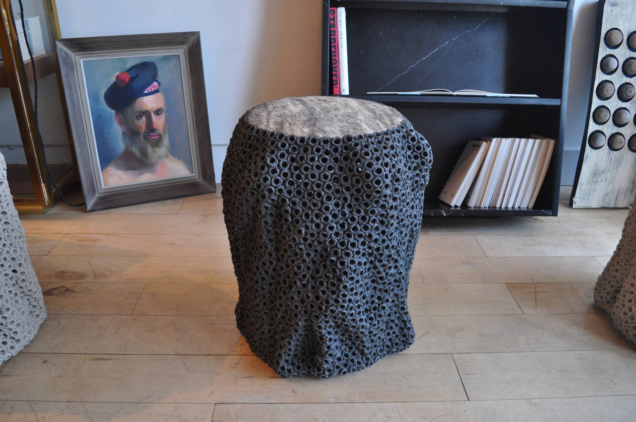 Extraordinary handcrafted pierced stoneware stool with cow hair top-gray. This piece works great as a side table or a stool. Signed by the artist.