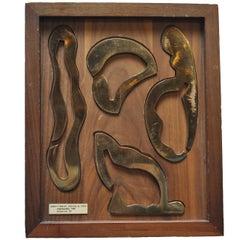 """Interlocution"" bronze puzzle in display case"