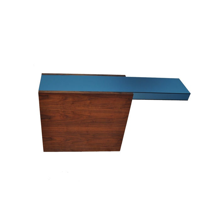 The DJ console is part of the Siglo Moderno in house furniture collection. It is inspired by the minimalism art movement. The DJ console is part of a family of tables. Also available is the DJ coffee table, DJ end table, DJ round coffee table, and