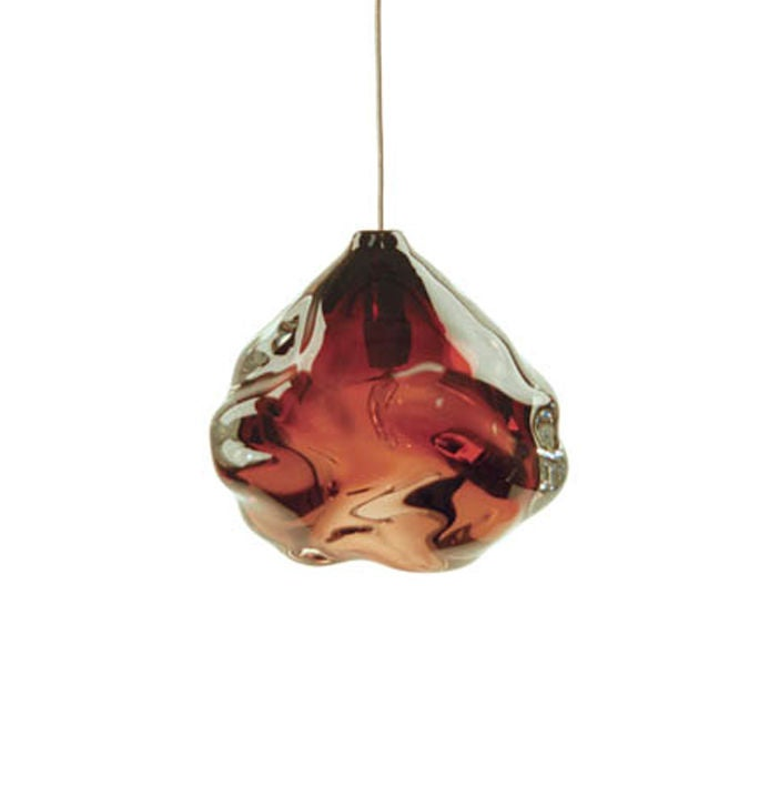Heavy thick-walled pieces are hand manipulated to create a creased and singularly individual form while taking advantage of the thickness and brilliance of the crystal to create a light with unending refractions. Sconce version also available. These