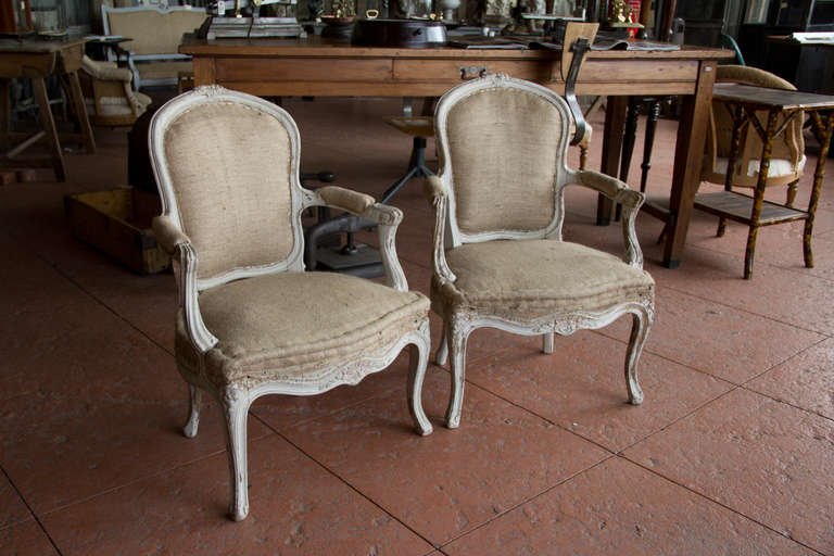 Charmant Pair Of Early 20th Century French Bergère Chairs With Remnants Of Its  Original Paint Showing.