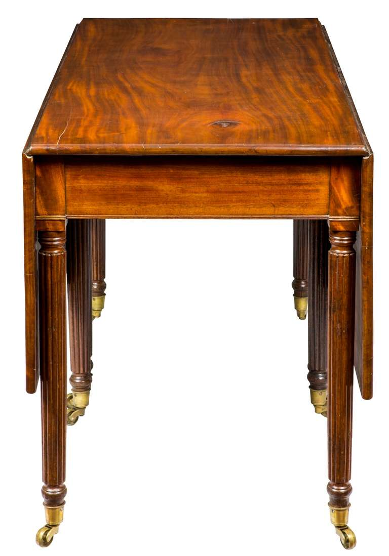 19th Century Mahogany Drop-Leaf Table with Eight Reeded Legs, Probably American, circa 1810 For Sale
