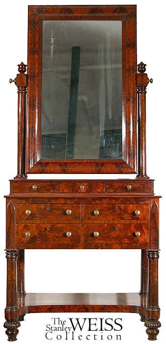 This is a very tall dressing mirror, however, no wider than most. It exhibits the finest craftsmanship and mahogany available at the time. The decoration is quite restrained, however, detail is executed at every point, for example, just below the