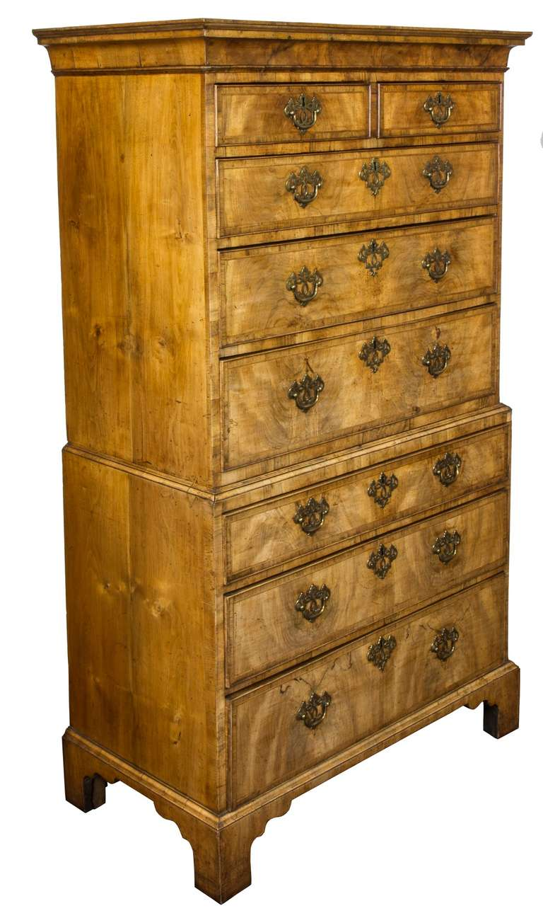 This chest-on-chest is in magnificent condition. There are no repairs or alterations whatsoever. The brasses are clearly original, which is quite rare and the feet (which are often lost and replaced) are unquestionably first. These are heavy pieces,