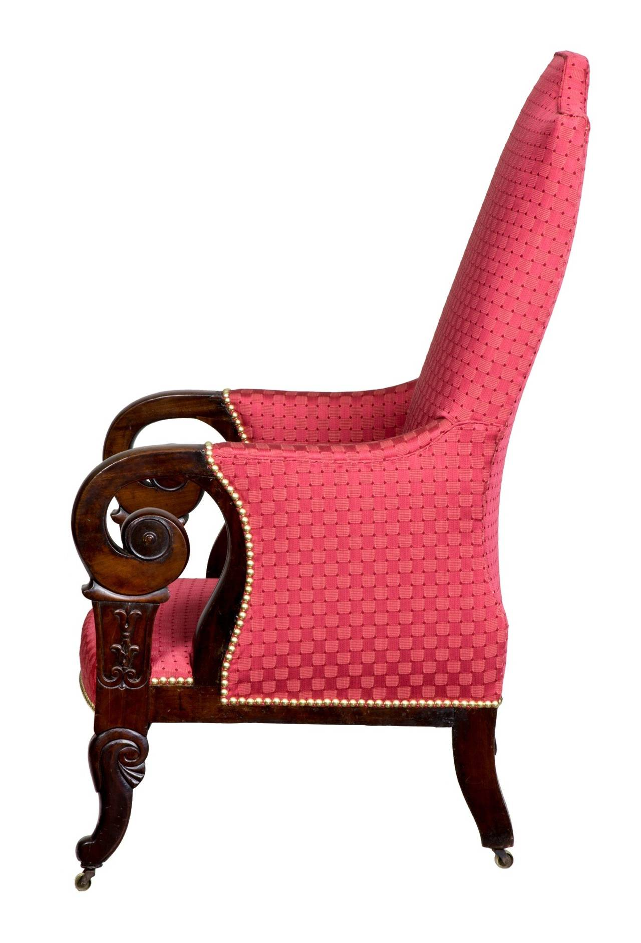 This is an interesting chair. The wood is heavy, dark, dense mahogany and is very heavy. The arms and their supports are beautifully crafted, as are the legs. Of particular interest is the back crest of this chair. These are quite rare and relates
