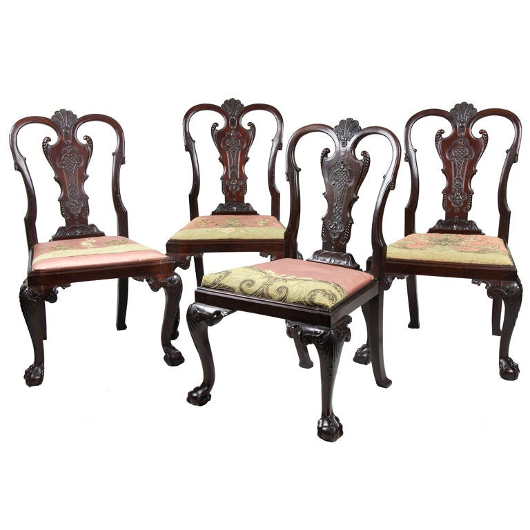 Set of Four Highly Carved Chippendale Side Chairs