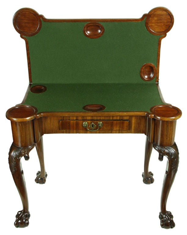Starting with the open talon claw and ball feet—a rarity—this table has it all. It has the desirable concertina action, which makes for a very sturdy table, and is highly sought after by collectors. The legs have leaf carving on the knees with