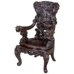 Magnificent Carved Japanese Armchair with Inset Ivory, circa 1890-1910