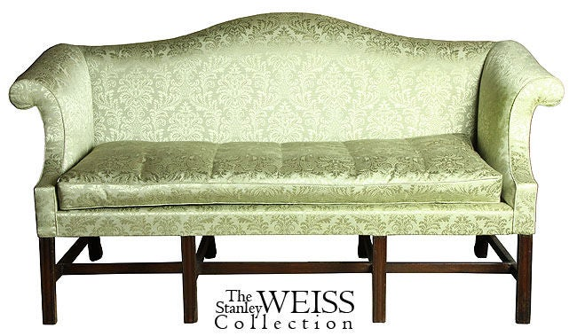 This is a small-scale sofa (68 in. wide) supported on four molded legs, giving it a very stabile appearance. The lines are Classic. See the attached images of when Levy had it up holstered and other related examples, including J. Walton. It is a gem