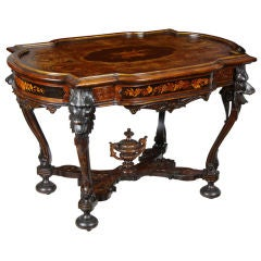 Rare Walnut Inlaid Center Table with Dramatic Wolf Heads