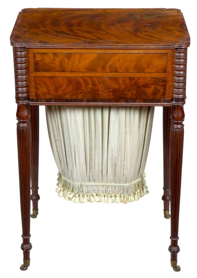 This work table has beautifully figured striped mahogany panels on all sides. Note the use of tiger mahogany between the front drawers. The legs are Classic Seymour; see the related examples pictured. The top is especially nice, it is composed of a