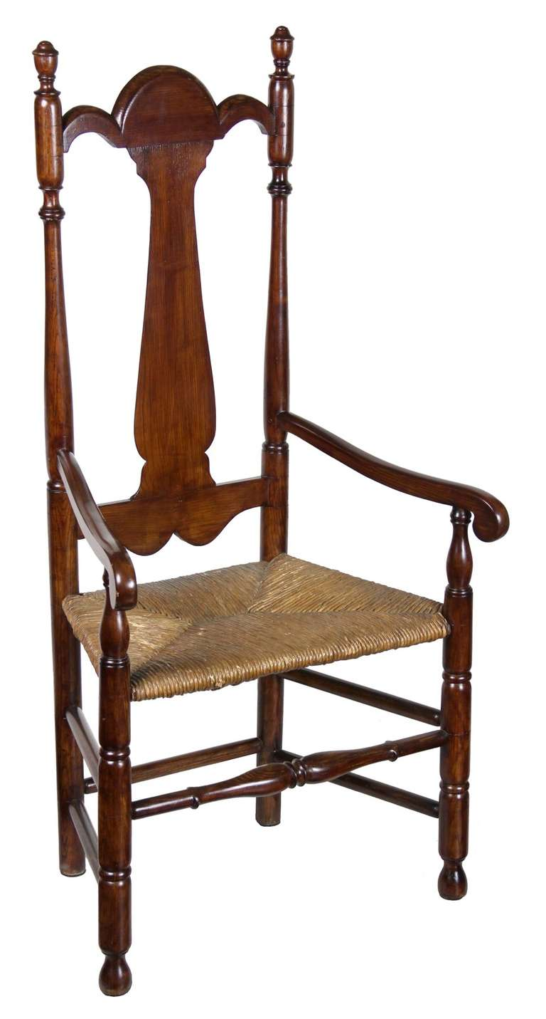 This stately chair has a very tall back, with beautifully sculpted splat that integrates nicely into the splat rail. The height of this chair gives it a commanding presence and its nicely sized seat is graciously inviting. Included below are images