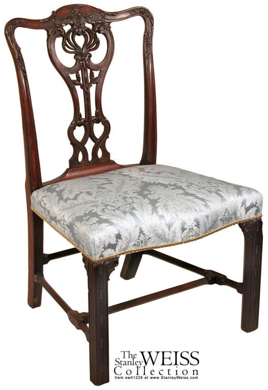 These chairs are some of the finest Chippendale side chairs available. Composed of heavy dark mahogany, with an old surface, the carving throughout is of the highest order. The seats are commodious and bowed in the front, all of which are supported