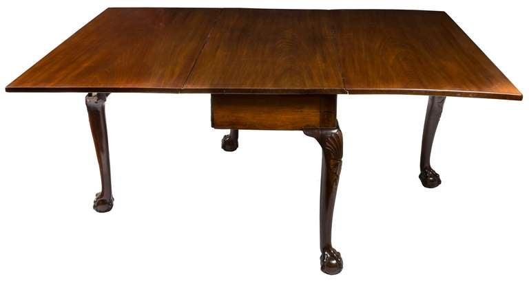 robust chippendale dining room table with carved knees and