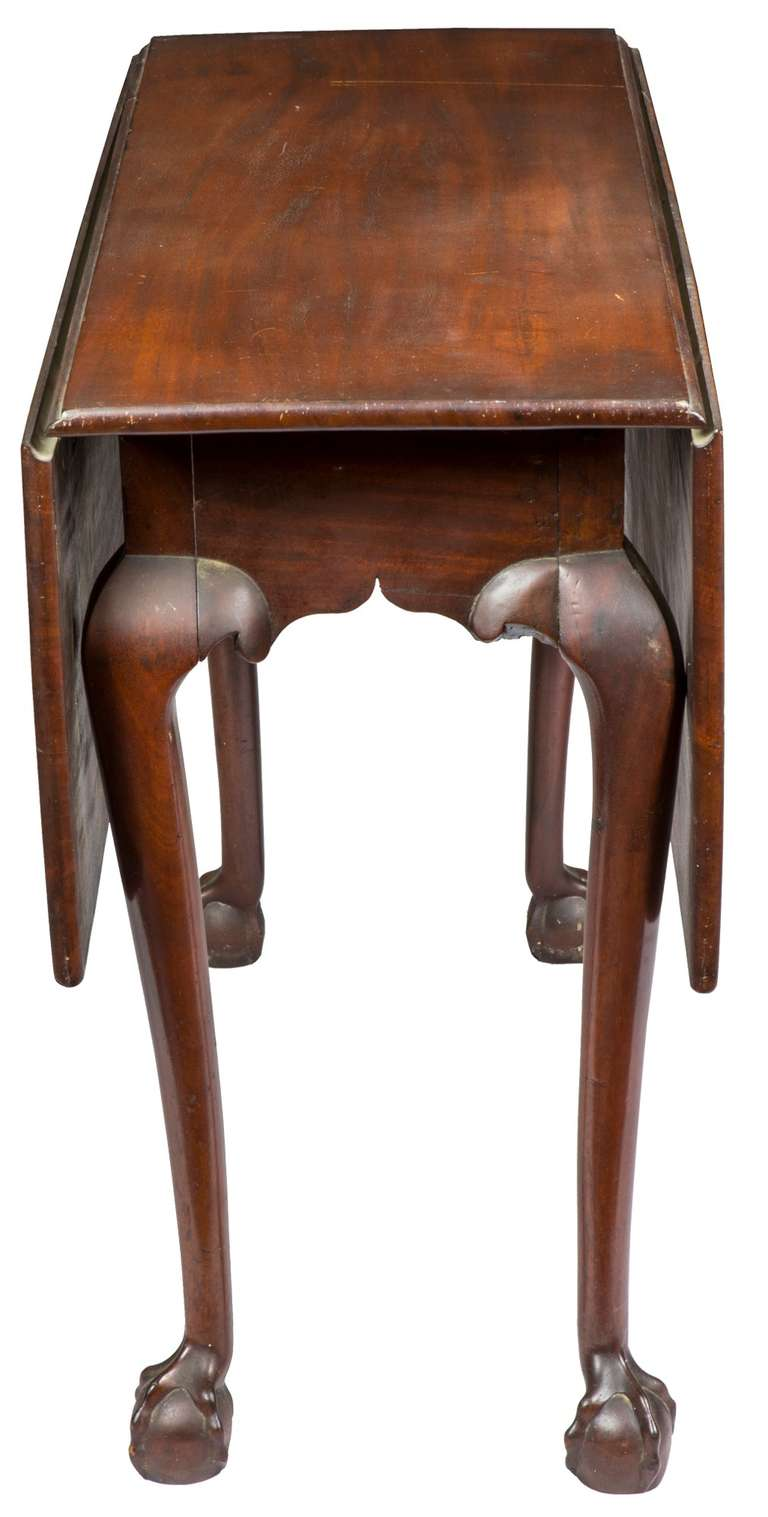 chippendale dropleaf table with striped mahogany and strong claw and ball feet 3