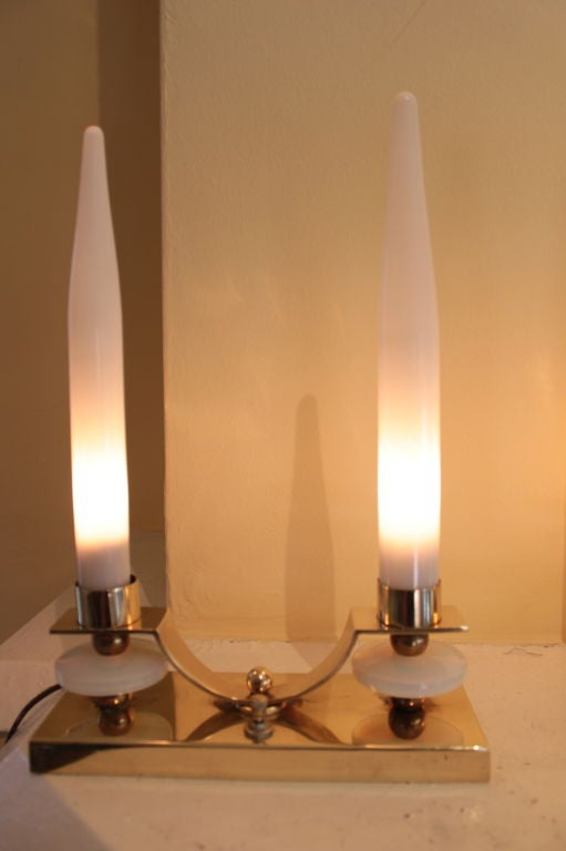 Pair of brass candlestick lamps with glass shades and opalescent glass discs.