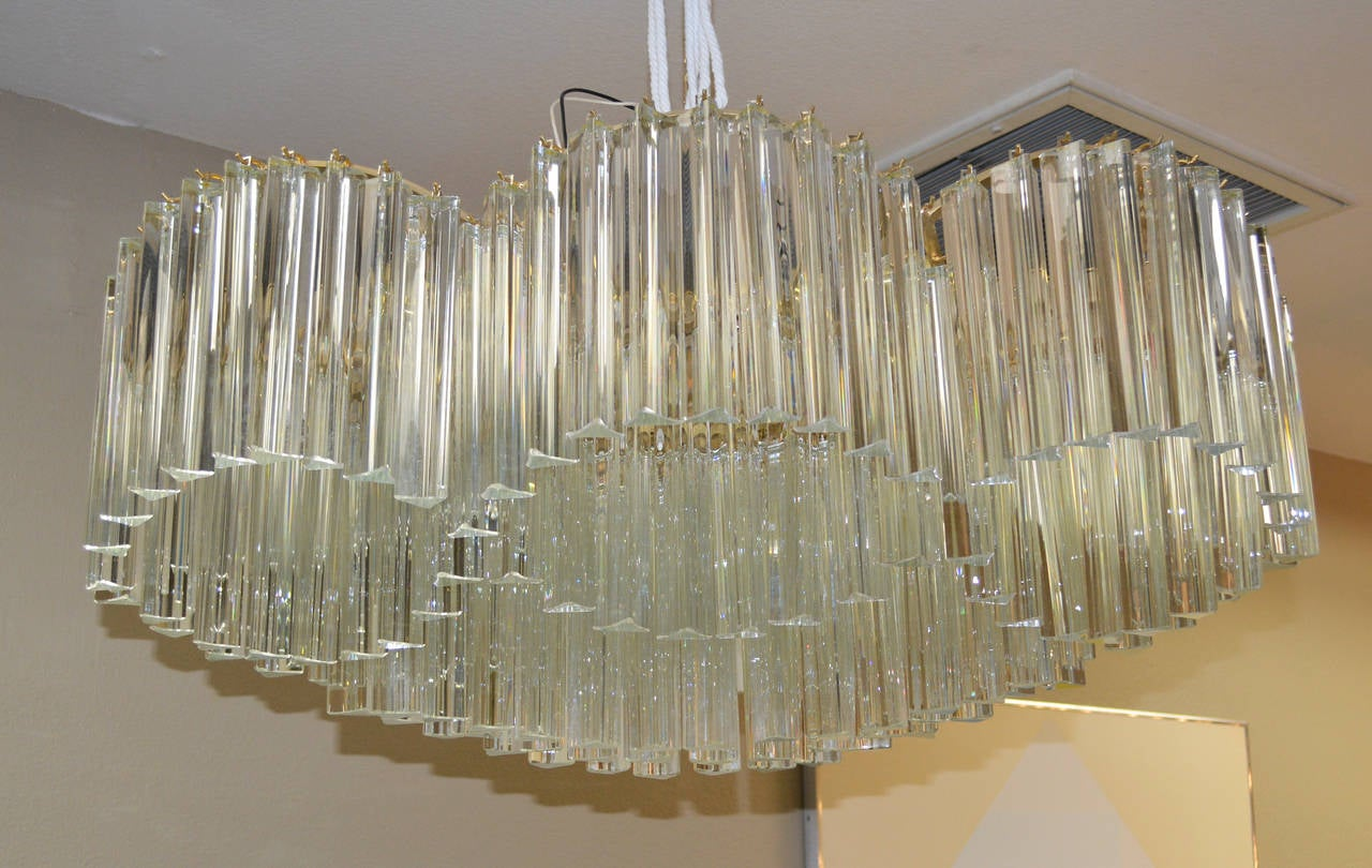 Unique and sculptural crystal chandelier by Camer Glass comprised of undulating bands of prisms.