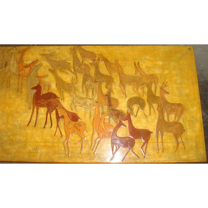 Yellow lacquer coffee table with a lovely three dimensional rendering of a herd of deer on top. Antiqued metal sabot on legs. Signed on bottom by Fumio Shimada, Originally retailed by Gracie.