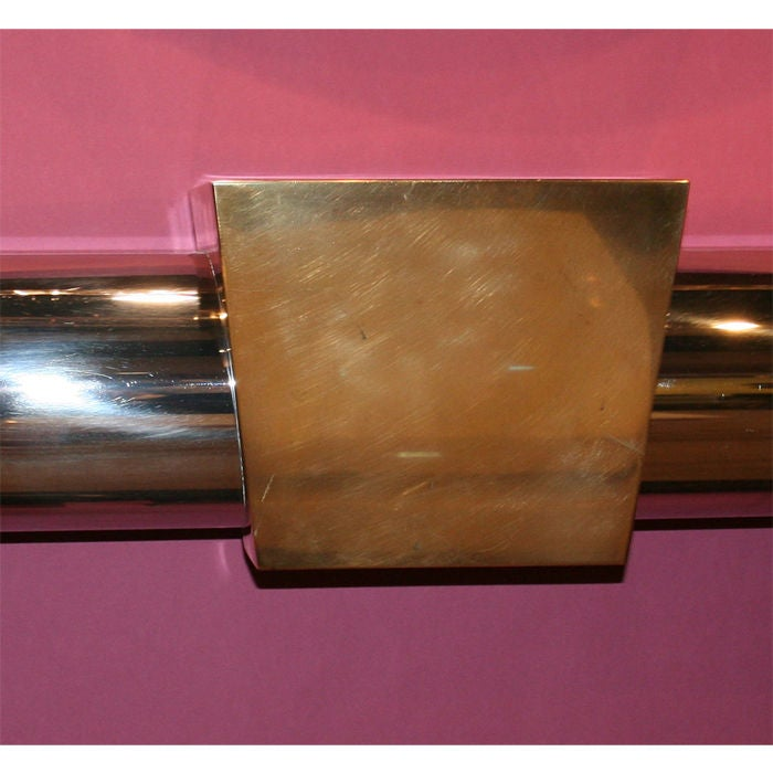 """Wonderful stainless steel and brass fireplace surround. Great quality and craftsmanship. Brass """"keystone"""" on a stainless steel half round frame. Interior dimensions are 53.5"""" wide x 38"""" high. Karl Springer style, most likely"""