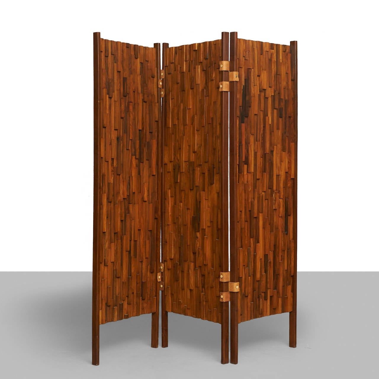 A pair of room dividers from Brazil. Made from predominantly rosewood, with additions of jacaranda, Pao Fero, Ipe and other hardwoods. Three panels each with leather hinges and brass details. Recently refinished. In the style of Percival