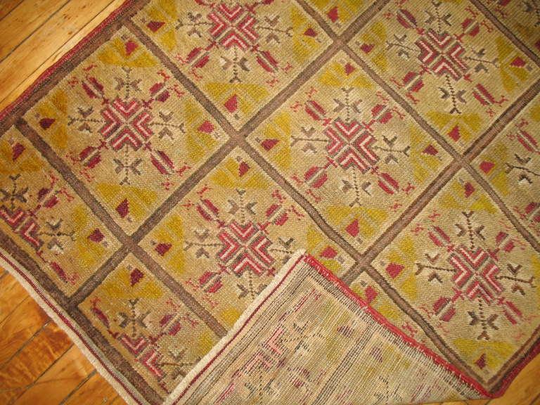 A Mid-Century Khotan rug in saffron.