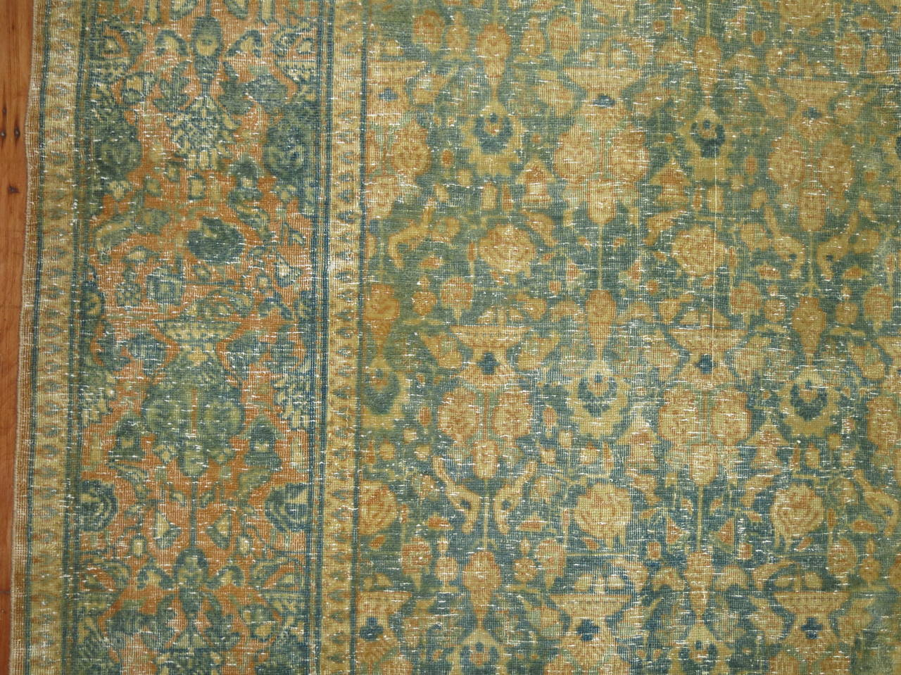 An early 20th century Persian Tabriz rug.