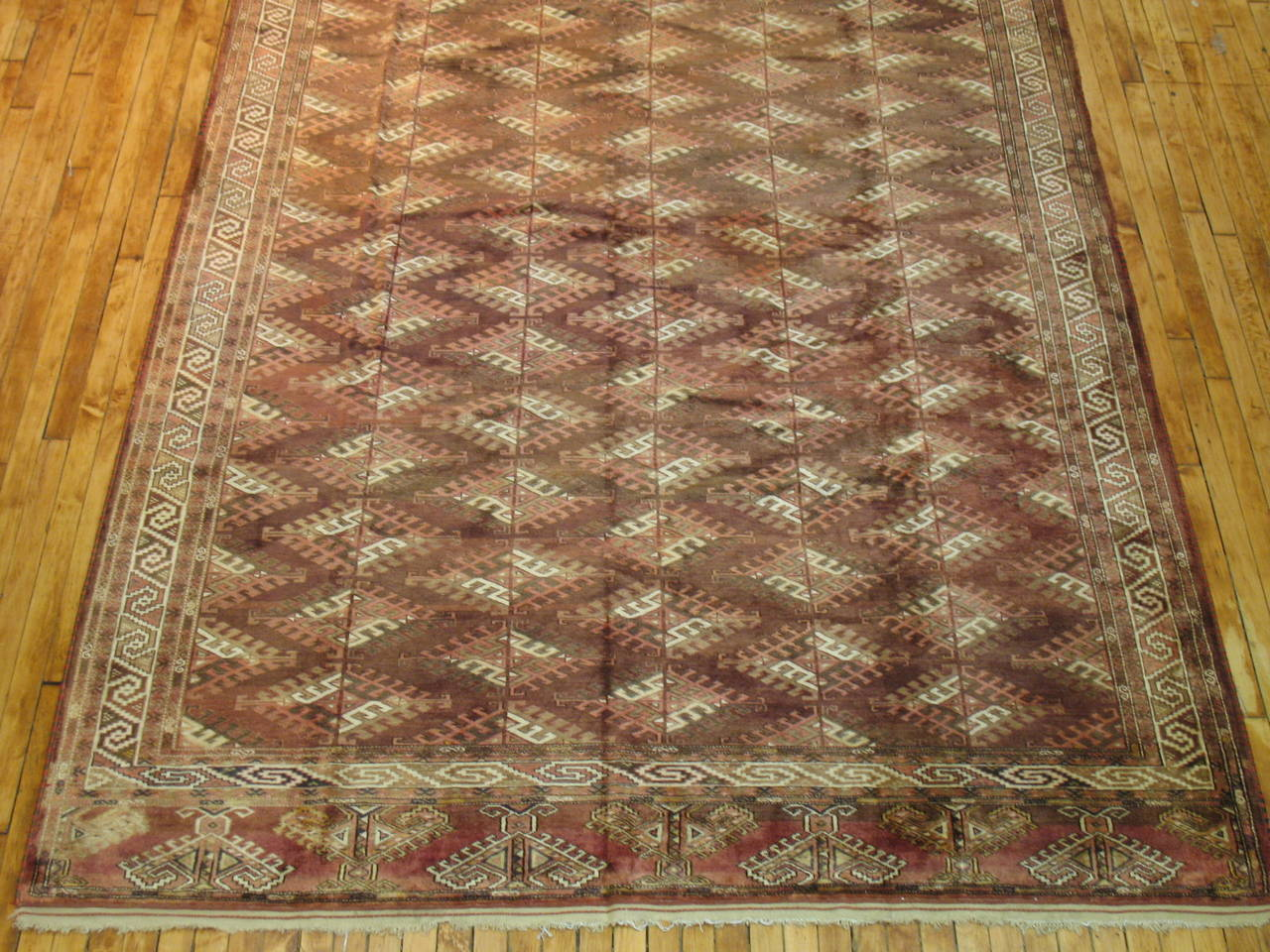 Rare size Turkoman rug. A Turkmen rug is a type of handmade floor-covering textile traditionally originating in Central Asia. Turkmen rugs were produced by the Turkmen tribes who are the main ethnic group in Turkmenistan and are also found in