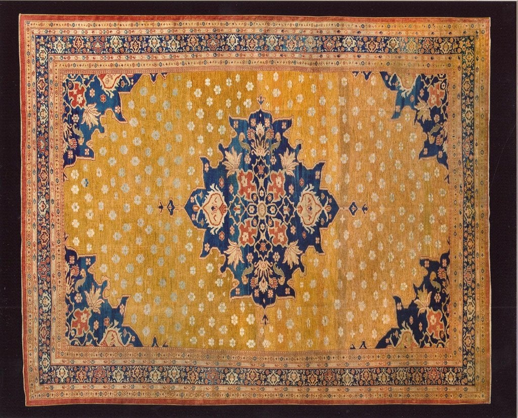 A masterful antique ziegler mahal Sultanabad rug. Gold field with enriched navy medallion and border. Superfine quality.