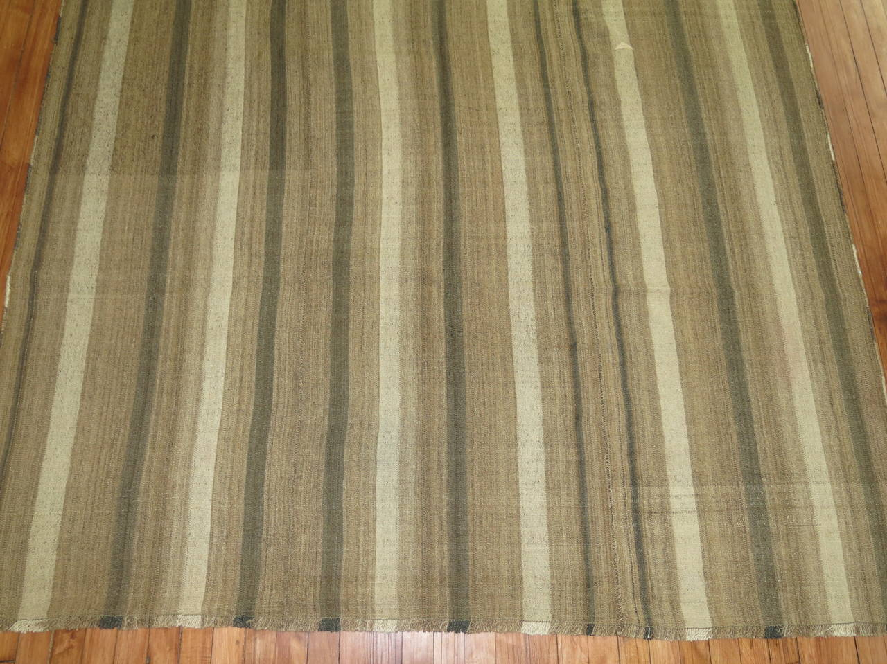 Midcentury Kilim in browns and khakis with a shade of soft coral in the top corner on one end.  Measures: 6'2