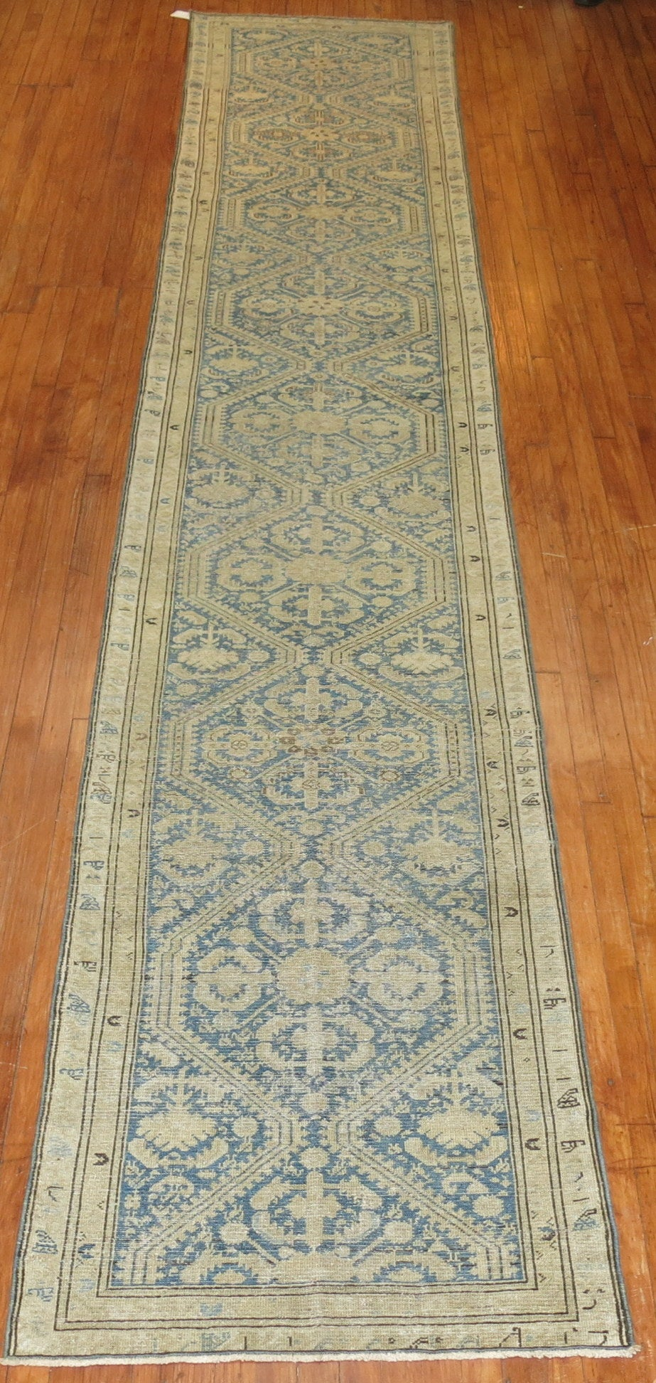 An early 20th century Persian Malayer runner in blues and gold.
