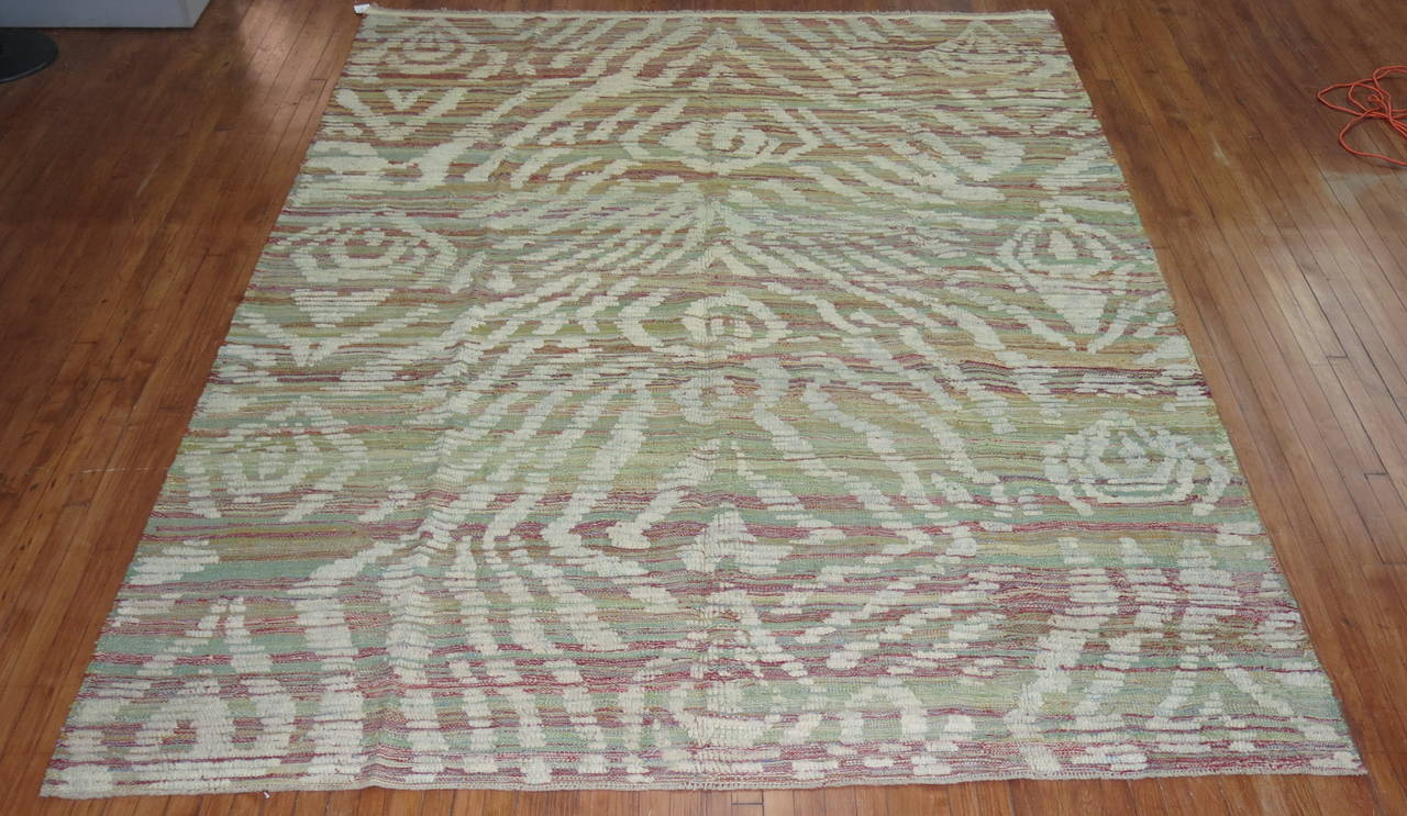 A one of a kind flat-weave carpet with a piled modern designed derived from old hand-spun wool used to make vintage Turkish Tulu rugs.