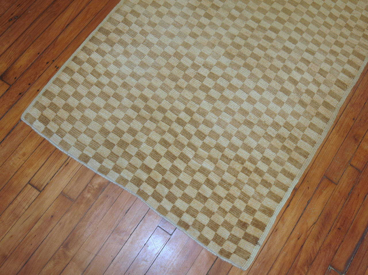 A vintage Turkish rug with a khaki and brown checkerboard pattern.  Size: 3'3