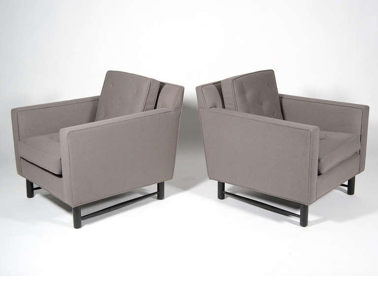 These two lounge chairs by Ed Wormley are perfectly proportioned with Classic lines. Dunbar quality is exceptional and the chairs have just been expertly reupholstered in a textured gray fabric. Of particular interest in this design are the