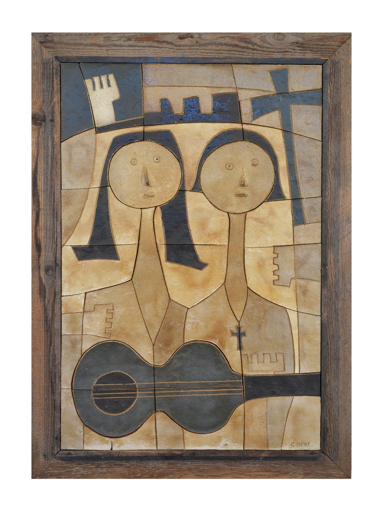 "A terrific wall piece by ceramic artist Clyde Burt (1922-1981). This piece features a male and female pair of Christian ""folkies"" with an acoustic guitar. Some of Burt's signature styles are evident in this piece including the stylized"