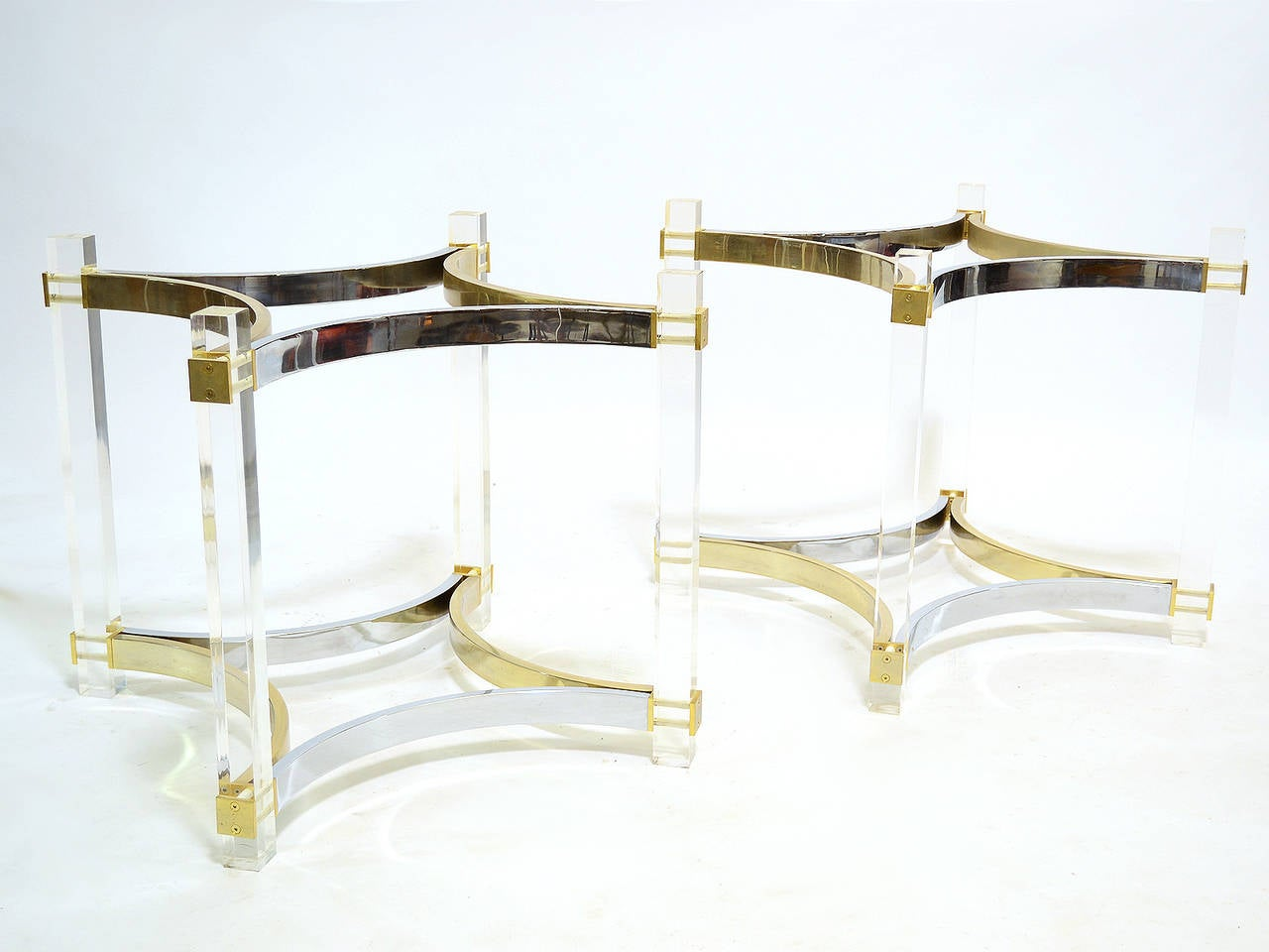 alessandro albrizzi dining table bases in lucite, brass, and