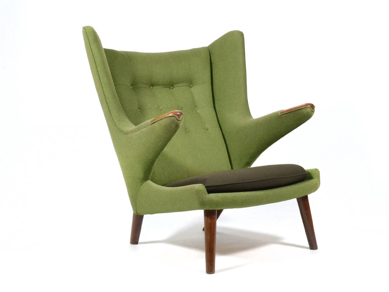 Renowned for it's beautiful design and incredible comfort, the Papa Bear chair has become an icon of 20th century Danish design. This exceptional example of Wegner's masterpiece is in amazing original condition. It features sage green fabric, a