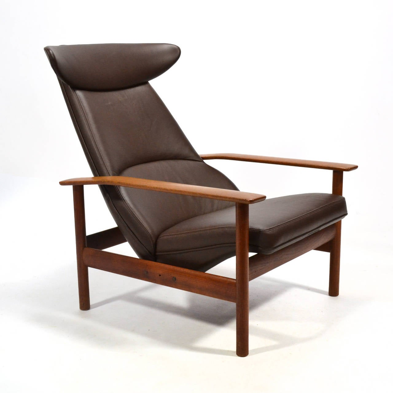 This exceptional lounge chair by Sven Ivar Dysthe for Dokka Mobler is a handsome, powerful design. With a frame of solid teak, the seat features a horn-shaped headrest (which reminds us of Hans Wegner's ox chair) and adjusts to two sitting