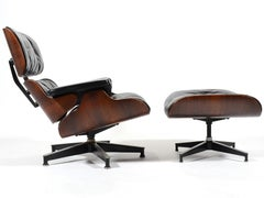 Rosweood and Down Eames Lounge Chair and Ottoman by Herman Miller
