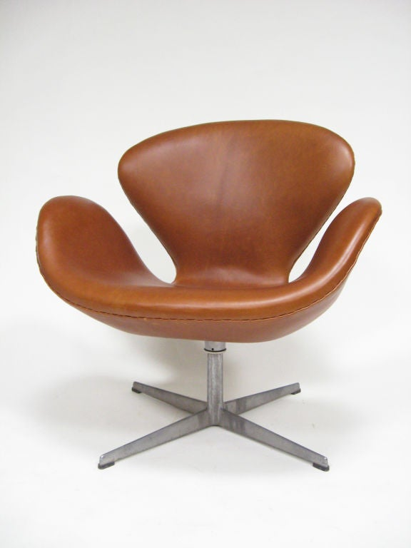 Beautiful vintage chair upholstered in rich cognac colored leather.