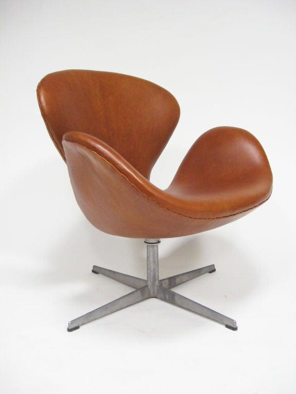 Danish Arne Jacobsen swan chair in cognac leather by Fritz Hansen