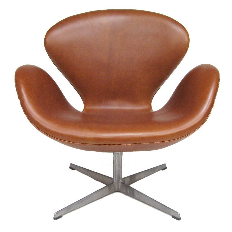 Arne Jacobsen swan chair in cognac leather by Fritz Hansen at 1stdibs