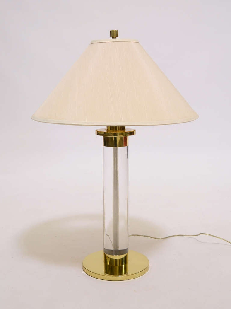 Frederick copper was known for the high quality of their lamps and this handsome table lamp in Lucite and brass is a prime example.