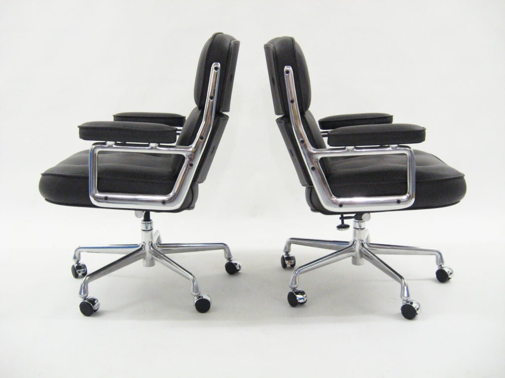 pair of leather eames time life chairs by herman miller at