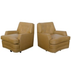 "Pair of ""Far East"" swivel club chairs by Baker"